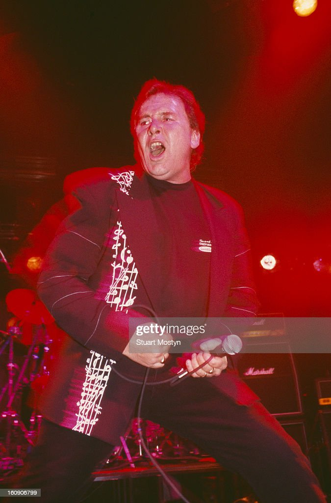 Singer Reg Presley of English pop group The Troggs performing at the Marquee Club London circa 1990