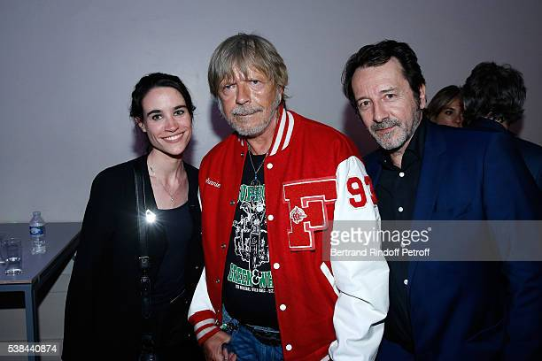 Singer Renaud Sechan standing between actor JeanHugues Anglade and his wife Charlotte attend the Concert of Patrick Bruel at Theatre Du Chatelet on...