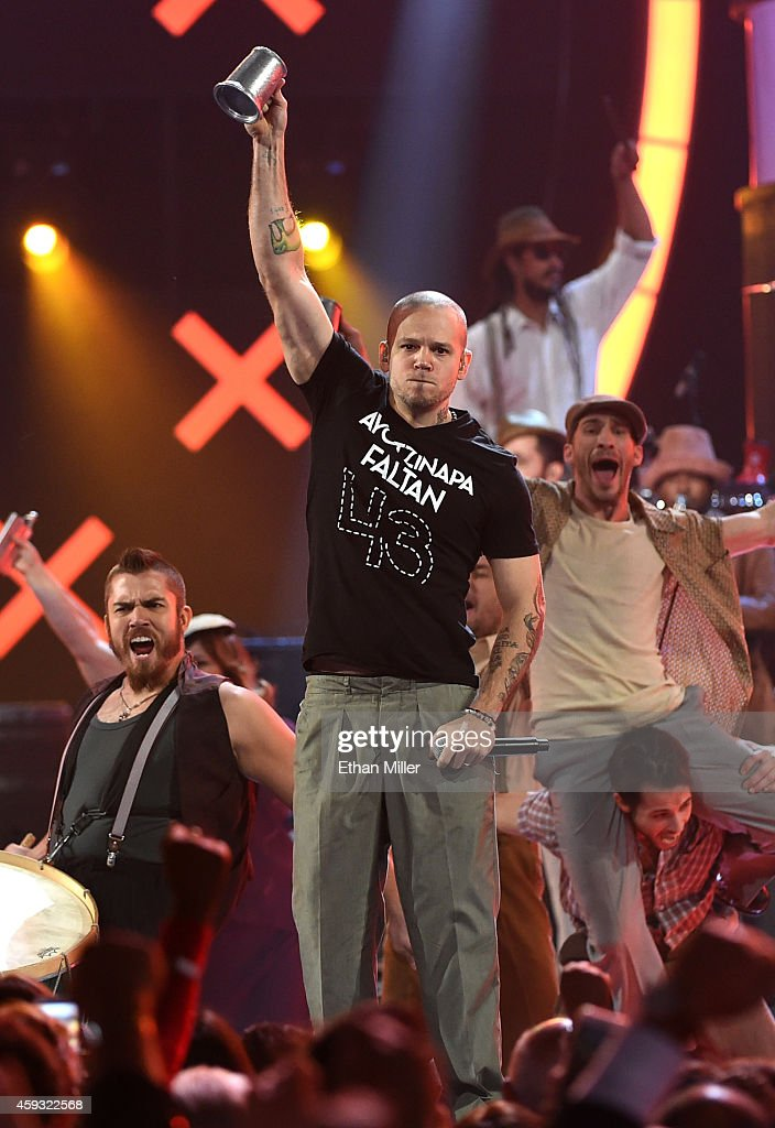 Singer <a gi-track='captionPersonalityLinkClicked' href=/galleries/search?phrase=Rene+Perez+Joglar&family=editorial&specificpeople=4617443 ng-click='$event.stopPropagation()'>Rene Perez Joglar</a> of Calle 13 performs onstage during the 15th Annual Latin GRAMMY Awards at the MGM Grand Garden Arena on November 20, 2014 in Las Vegas, Nevada.