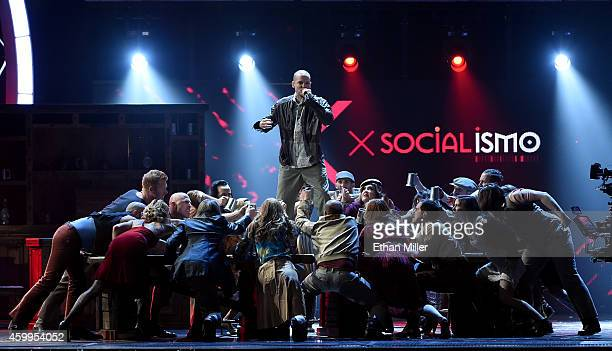 Singer Rene Perez Joglar of Calle 13 performs with dancers during the 15th annual Latin GRAMMY Awards at the MGM Grand Garden Arena on November 20...