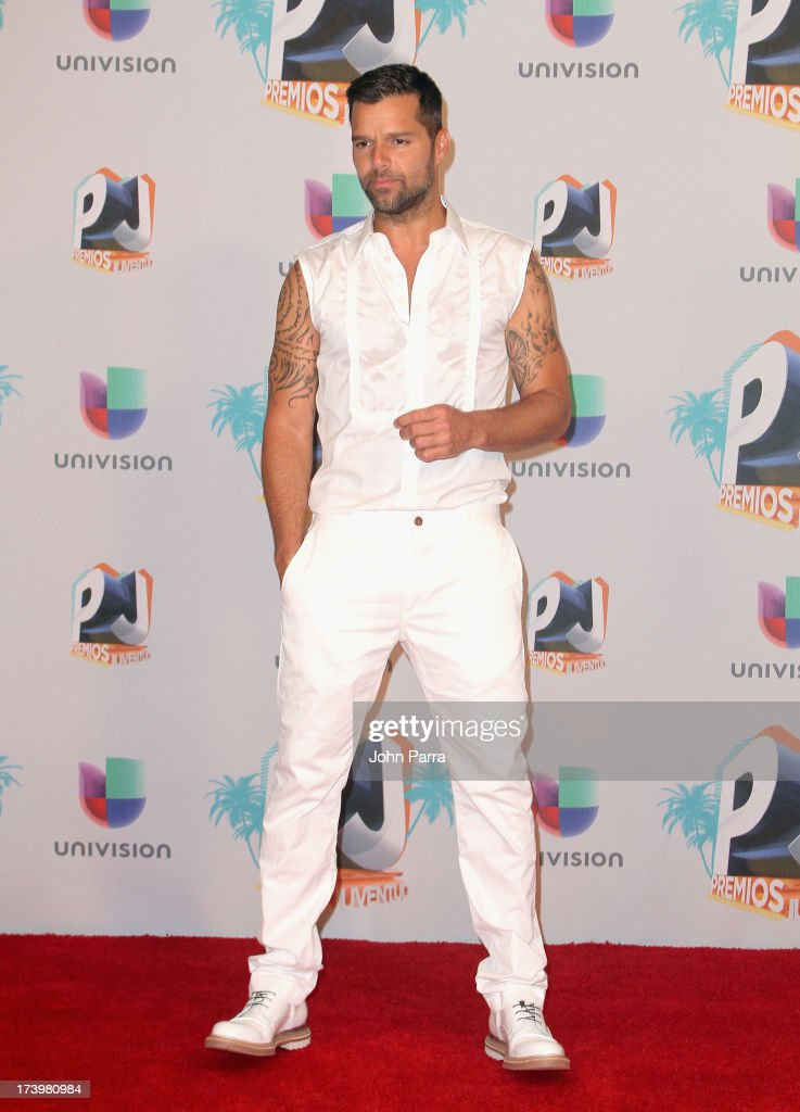 Singer <a gi-track='captionPersonalityLinkClicked' href=/galleries/search?phrase=Ricky+Martin&family=editorial&specificpeople=160450 ng-click='$event.stopPropagation()'>Ricky Martin</a> poses in the press room during Premios Juventud 2013 at Bank United Center on July 18, 2013 in Miami, Florida.