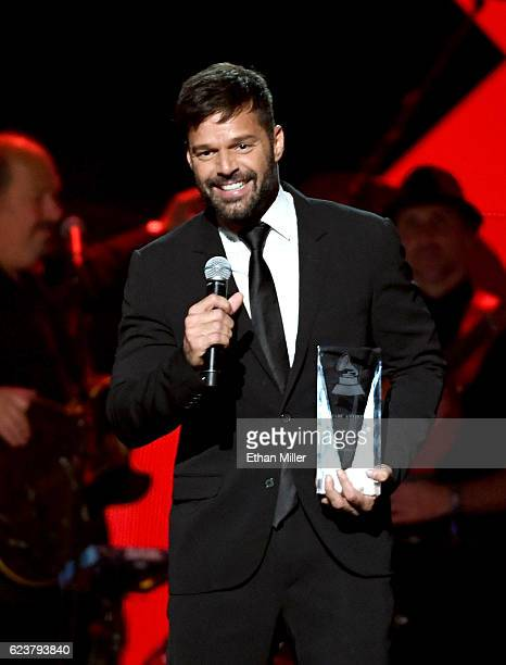 Singer Ricky Martin presents the Person of the Year award onstage during the 2016 Person of the Year honoring Marc Anthony at MGM Grand Garden Arena...