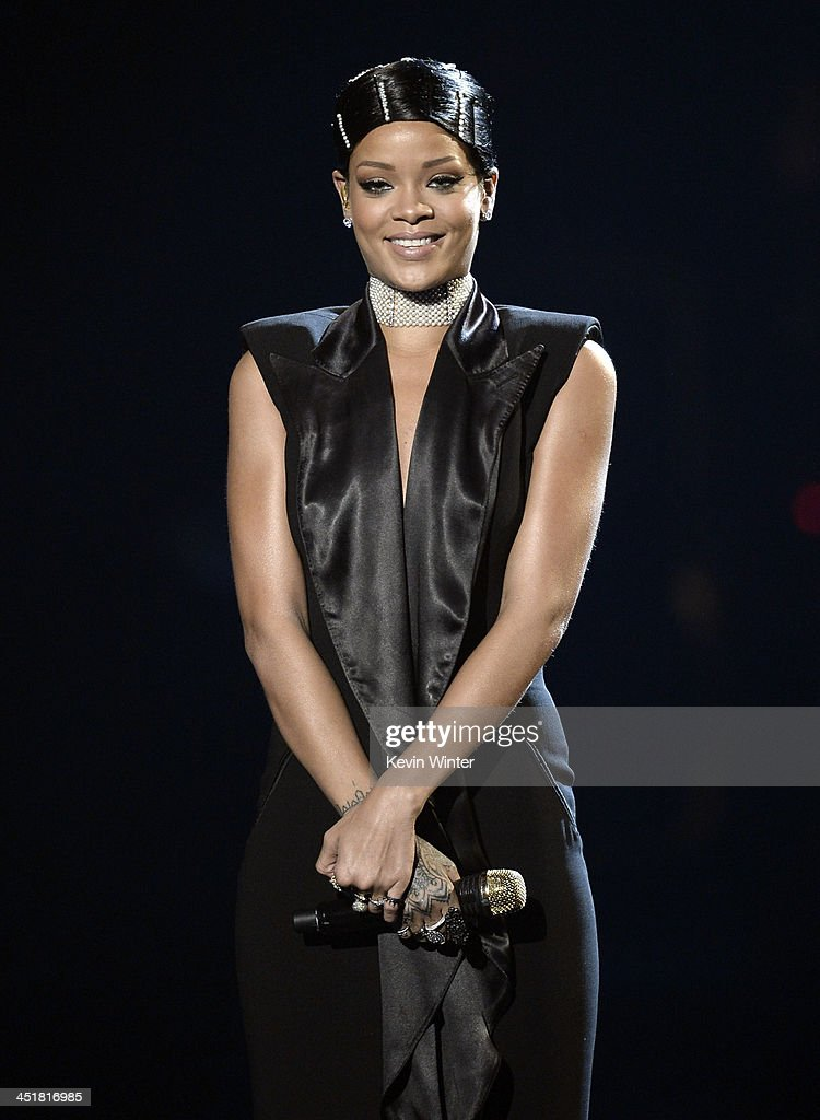 Singer Rihanna accepts the AMA Icon Award onstage during the 2013 American Music Awards at Nokia Theatre L.A. Live on November 24, 2013 in Los Angeles, California.
