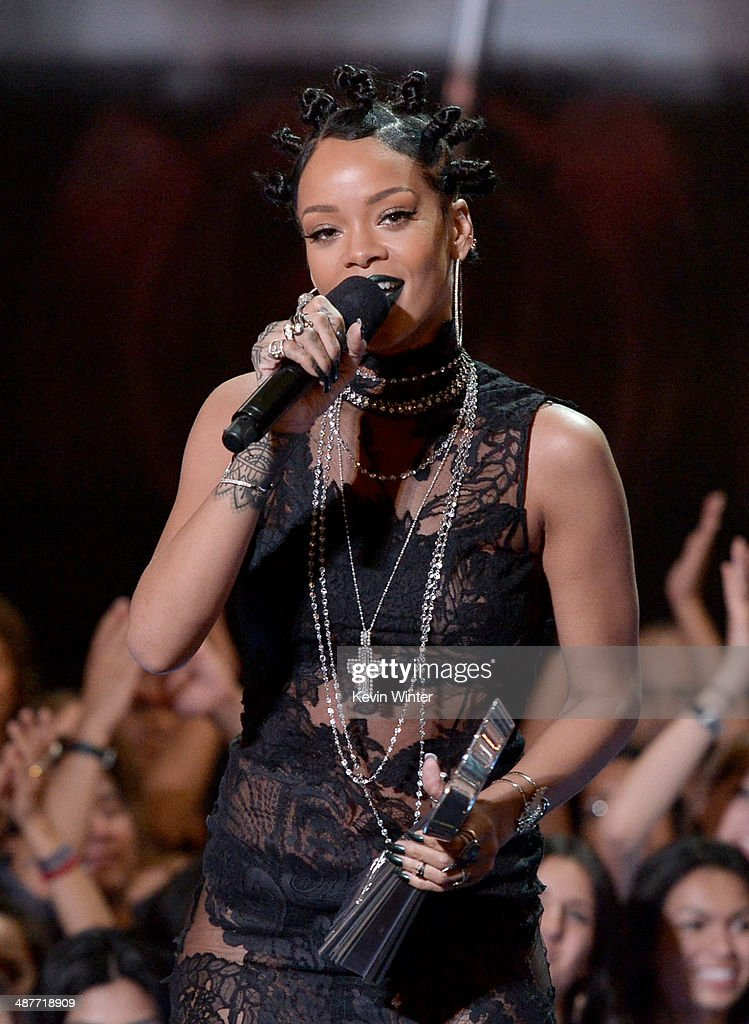Singer Rihanna accepts the Artist of the Year award onstage during the 2014 iHeartRadio Music Awards held at The Shrine Auditorium on May 1, 2014 in Los Angeles, California. iHeartRadio Music Awards are being broadcast live on NBC.