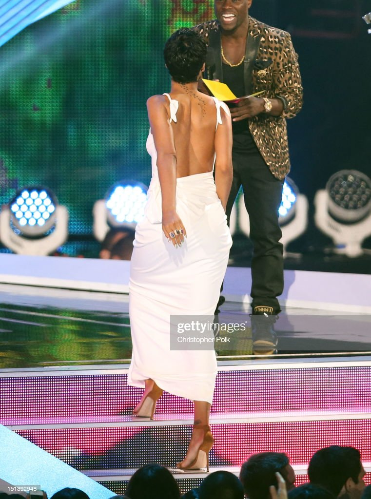 Singer <a gi-track='captionPersonalityLinkClicked' href=/galleries/search?phrase=Rihanna&family=editorial&specificpeople=453439 ng-click='$event.stopPropagation()'>Rihanna</a> accepts the award for Video of the Year from host <a gi-track='captionPersonalityLinkClicked' href=/galleries/search?phrase=Kevin+Hart+-+Actor&family=editorial&specificpeople=4538838 ng-click='$event.stopPropagation()'>Kevin Hart</a> onstage during the 2012 MTV Video Music Awards at Staples Center on September 6, 2012 in Los Angeles, California.