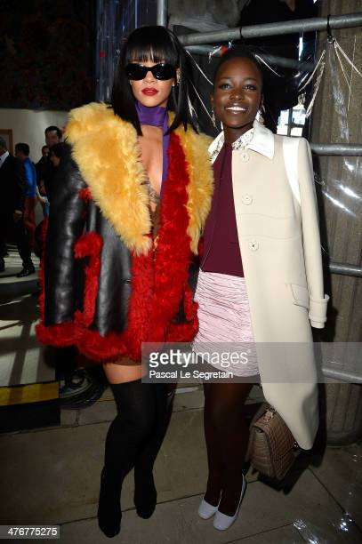 Singer Rihanna and actress Lupita Nyong'o attend the Miu Miu show as part of the Paris Fashion Week Womenswear Fall/Winter 20142015 on March 5 2014...