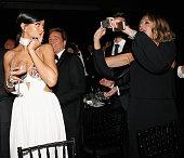 Singer Rihanna and Actress Rita Wilson attend amfAR LA Inspiration Gala honoring Tom Ford at Milk Studios on October 29 2014 in Hollywood California