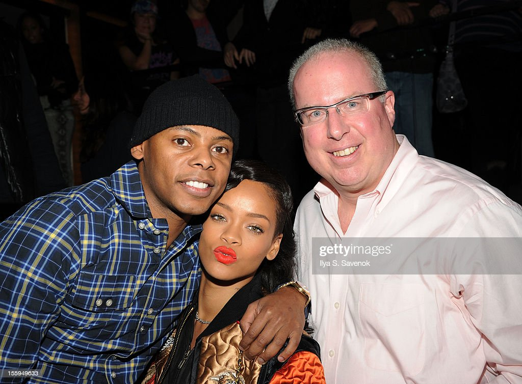 Singer Rihanna (C) and President/COO of Island Def Jam Music Group, Steve Bartels (R) attend the pre-release preview of Rihanna's new album 'Unapologetic' at 40 / 40 Club on November 9, 2012 in New York City.