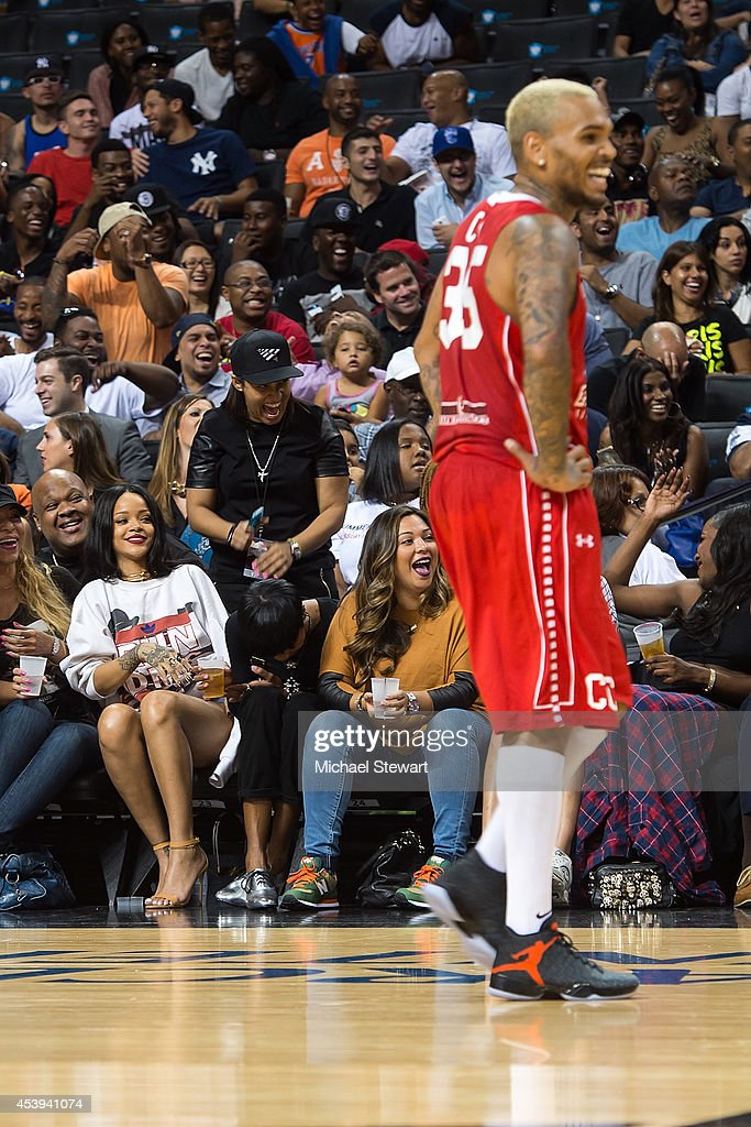 Singer <a gi-track='captionPersonalityLinkClicked' href=/galleries/search?phrase=Rihanna&family=editorial&specificpeople=453439 ng-click='$event.stopPropagation()'>Rihanna</a> (L) and rapper Chris Brown attend the 2014 Summer Classic Charity Basketball Game at Barclays Center on August 21, 2014 in New York City.