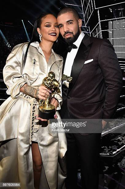 Singer Rihanna and rapper Drake pose onstage during the 2016 MTV Video Music Awards at Madison Square Garden on August 28 2016 in New York City