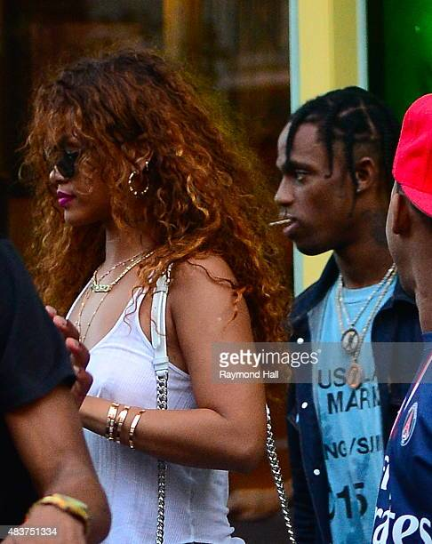 Singer Rihanna and Travis Scott are seen coming out of Coppelia restaurant in Soho on August 12 2015 in New York City