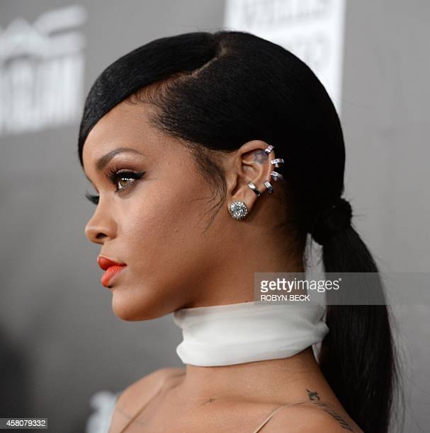 Singer Rihanna attends amfARs fifth annual Inspiration Gala in Los Angeles October 29 2014 at Milk Studios in Hollywood California AFP PHOTO / ROBYN...