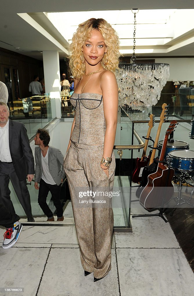 Singer <a gi-track='captionPersonalityLinkClicked' href=/galleries/search?phrase=Rihanna&family=editorial&specificpeople=453439 ng-click='$event.stopPropagation()'>Rihanna</a> attends the 4th Annual Roc Nation Pre-GRAMMY Brunch at Soho House on February 11, 2012 in West Hollywood, California.