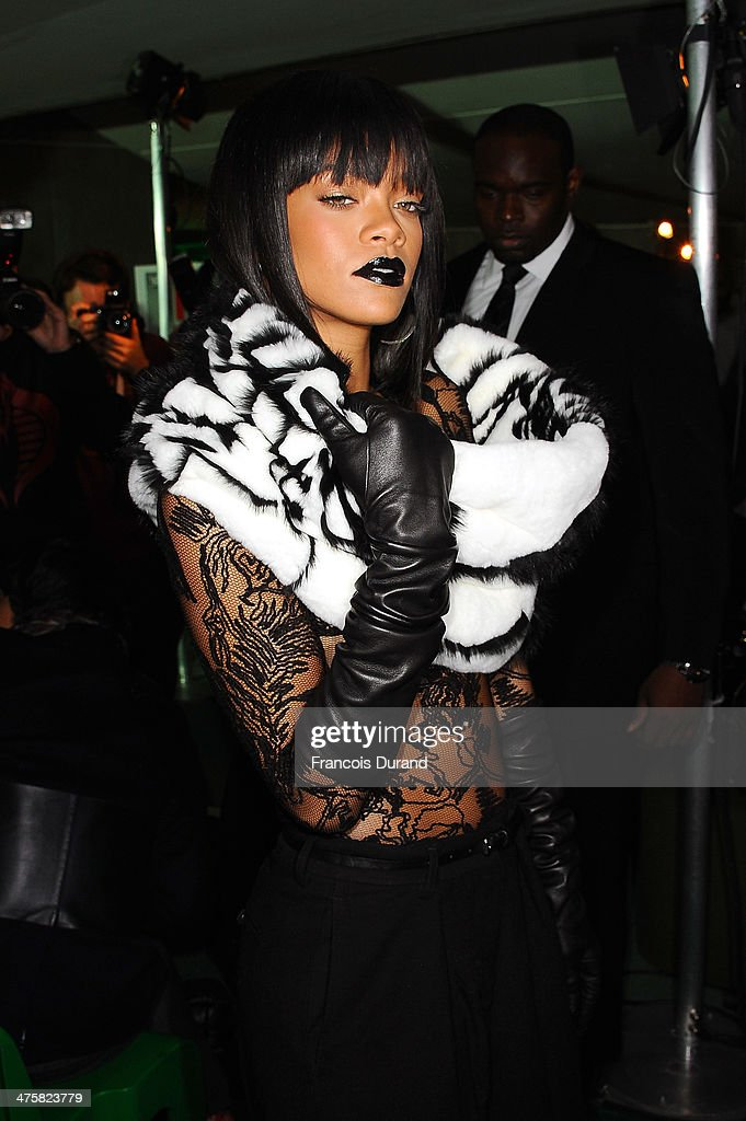 Singer <a gi-track='captionPersonalityLinkClicked' href=/galleries/search?phrase=Rihanna&family=editorial&specificpeople=453439 ng-click='$event.stopPropagation()'>Rihanna</a> attends the Jean Paul Gaultier show as part of the Paris Fashion Week Womenswear Fall/Winter 2014-2015 on March 1, 2014 in Paris, France.