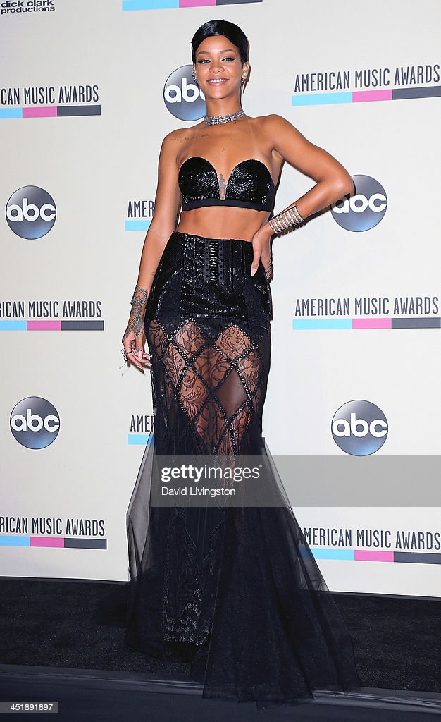 Singer <a gi-track='captionPersonalityLinkClicked' href=/galleries/search?phrase=Rihanna&family=editorial&specificpeople=453439 ng-click='$event.stopPropagation()'>Rihanna</a> attends the press room at the 2013 American Music Awards at Nokia Theatre L.A. Live on November 24, 2013 in Los Angeles, California.