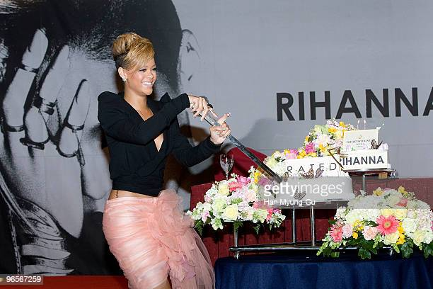 Singer Rihanna cuts her birthday cake during a press conference to promote her latest album 'Rated R' at Intercontinental hotel on February 11 2010...