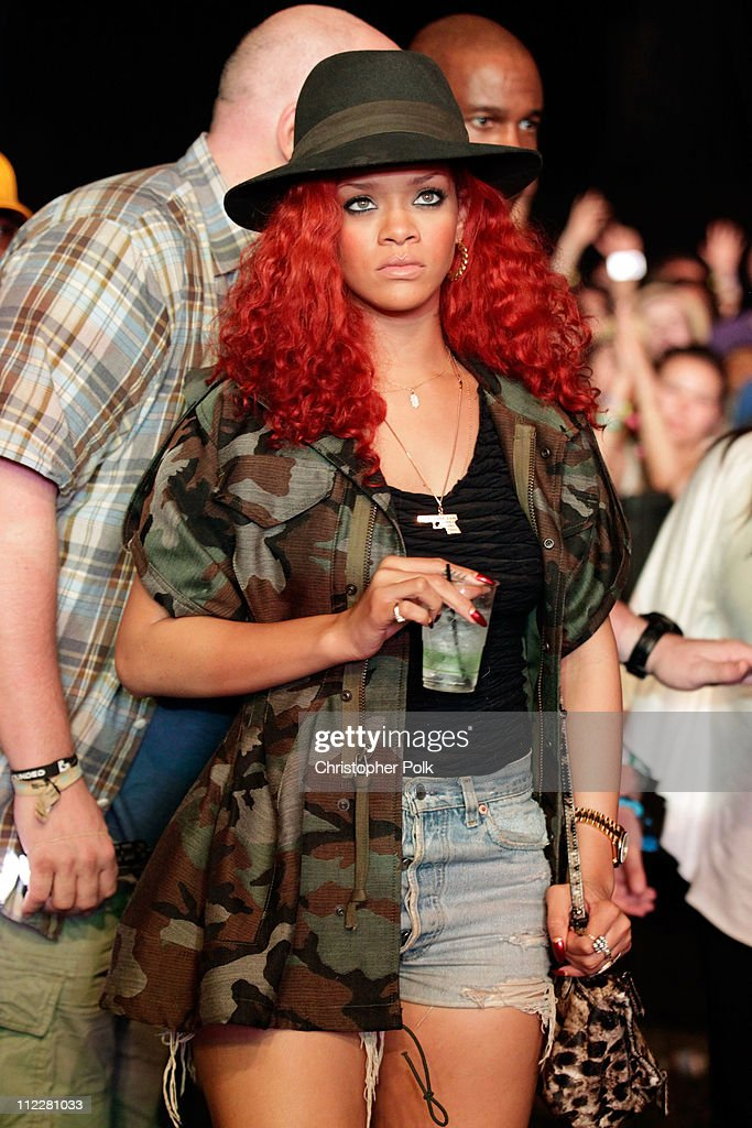 Singer <a gi-track='captionPersonalityLinkClicked' href=/galleries/search?phrase=Rihanna&family=editorial&specificpeople=453439 ng-click='$event.stopPropagation()'>Rihanna</a> in the audience during Day 2 of the Coachella Valley Music & Arts Festival 2011 held at the Empire Polo Club on April 16, 2011 in Indio, California.