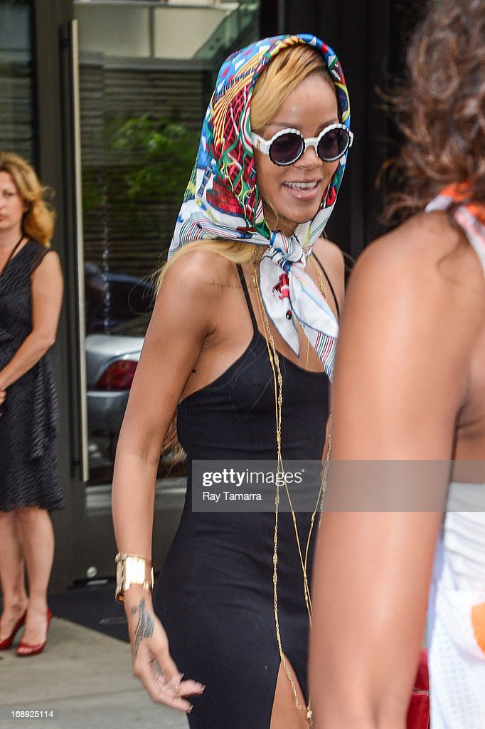 Singer <a gi-track='captionPersonalityLinkClicked' href=/galleries/search?phrase=Rihanna&family=editorial&specificpeople=453439 ng-click='$event.stopPropagation()'>Rihanna</a> leaves her Midtown Manhattan hotel on May 16, 2013 in New York City.