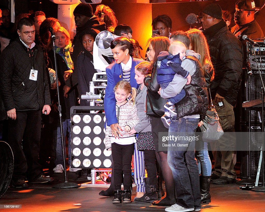 Singer <a gi-track='captionPersonalityLinkClicked' href=/galleries/search?phrase=Rihanna&family=editorial&specificpeople=453439 ng-click='$event.stopPropagation()'>Rihanna</a> meets fans after switching on the Christmas lights at Westfield Stratford City with young ambassadors from Save The Children, Westfield's chosen Christmas charity, on November 19, 2012 in London, England.