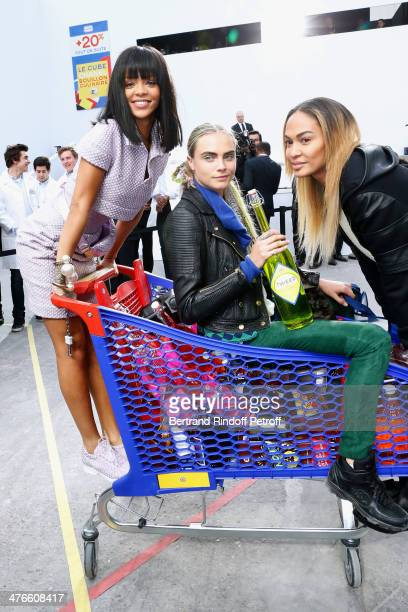 Singer Rihanna model Cara Delevingne and a model have fun after the Chanel show as part of the Paris Fashion Week Womenswear Fall/Winter 20142015 on...