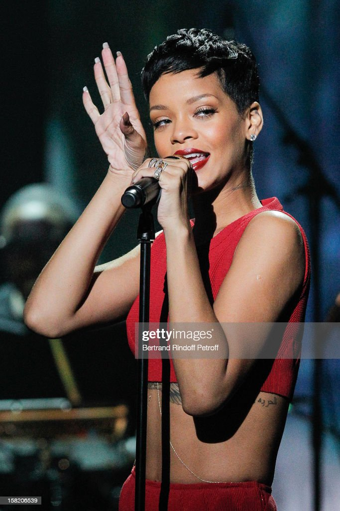Singer <a gi-track='captionPersonalityLinkClicked' href=/galleries/search?phrase=Rihanna&family=editorial&specificpeople=453439 ng-click='$event.stopPropagation()'>Rihanna</a> performs during 'La Chanson De L'Annee 2012' Show Recording at Palais des Sports on December 10, 2012 in Paris, France.