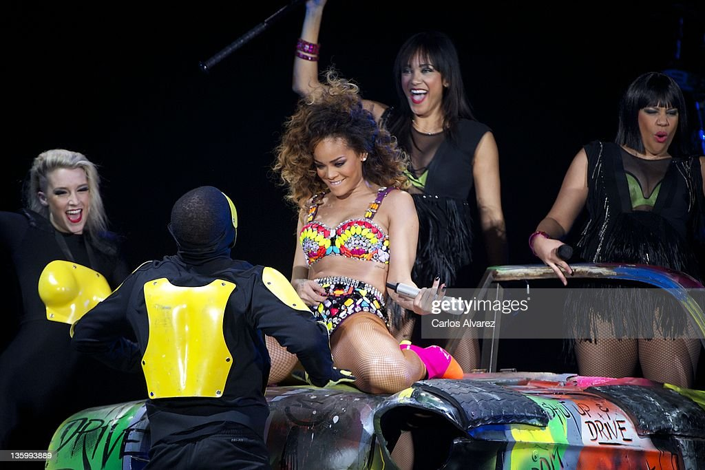 Singer <a gi-track='captionPersonalityLinkClicked' href=/galleries/search?phrase=Rihanna&family=editorial&specificpeople=453439 ng-click='$event.stopPropagation()'>Rihanna</a> performs on stage at the Palacio de los Deportes stadium on December 15, 2011 in Madrid, Spain.