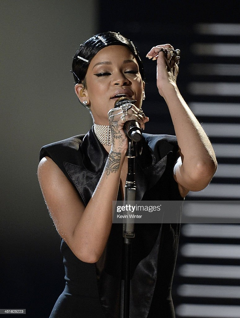 Singer Rihanna performs onstage during the 2013 American Music Awards at Nokia Theatre L.A. Live on November 24, 2013 in Los Angeles, California.
