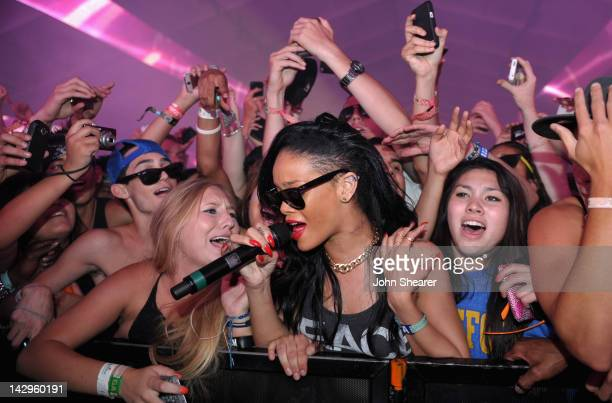 Singer Rihanna performs with DJ Calvin Harris during Day 3 of the 2012 Coachella Valley Music Arts Festival held at the Empire Polo Club on April 15...