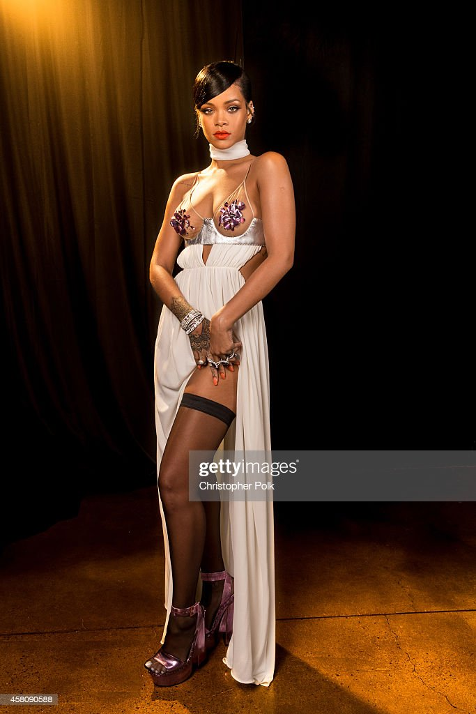 Singer <a gi-track='captionPersonalityLinkClicked' href=/galleries/search?phrase=Rihanna&family=editorial&specificpeople=453439 ng-click='$event.stopPropagation()'>Rihanna</a> poses for photos backstage at Milk Studios on October 29, 2014 in Hollywood, California.