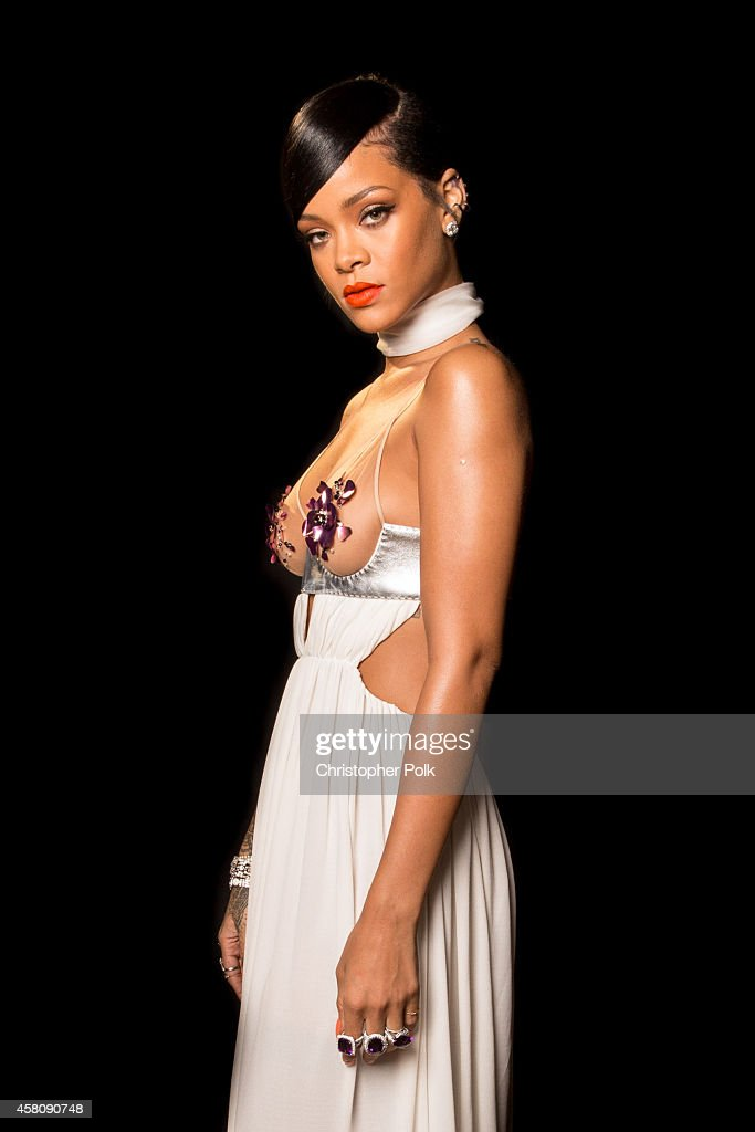 Singer Rihanna poses for photos backstage at Milk Studios on October 29, 2014 in Hollywood, California.