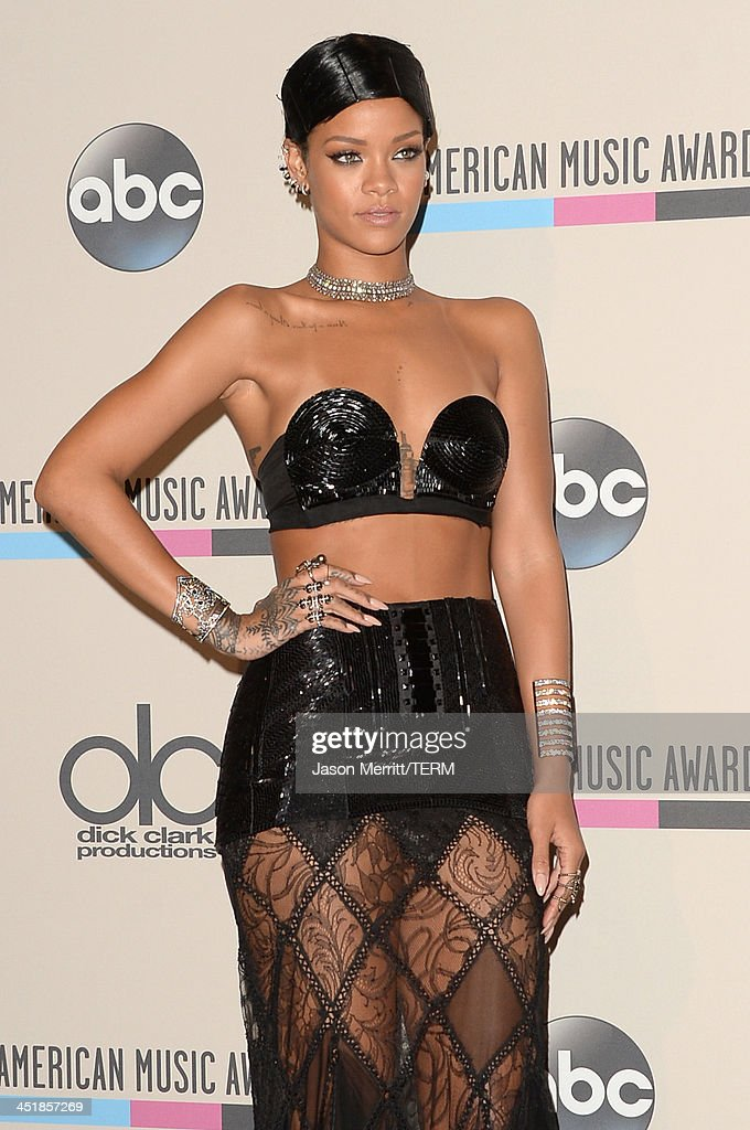 Singer Rihanna poses with the Icon Award in the press room during the 2013 American Music Awards at Nokia Theatre L.A. Live on November 24, 2013 in Los Angeles, California.