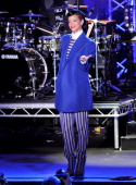 Singer Rihanna speaks before switching on the Christmas lights at Westfield Stratford City with young ambassadors from Save The Children Westfield's...