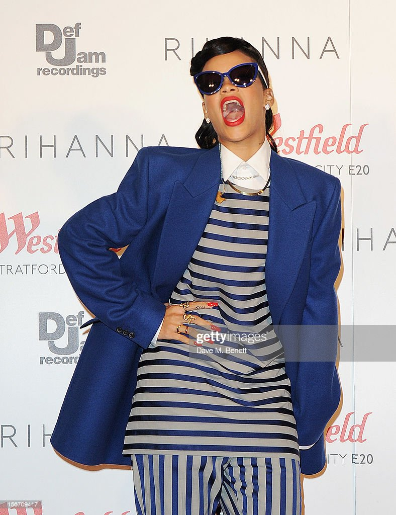 Singer Rihanna switches on the Christmas lights at Westfield Stratford City with young ambassadors from Save The Children, Westfield's chosen Christmas charity, on November 19, 2012 in London, England.