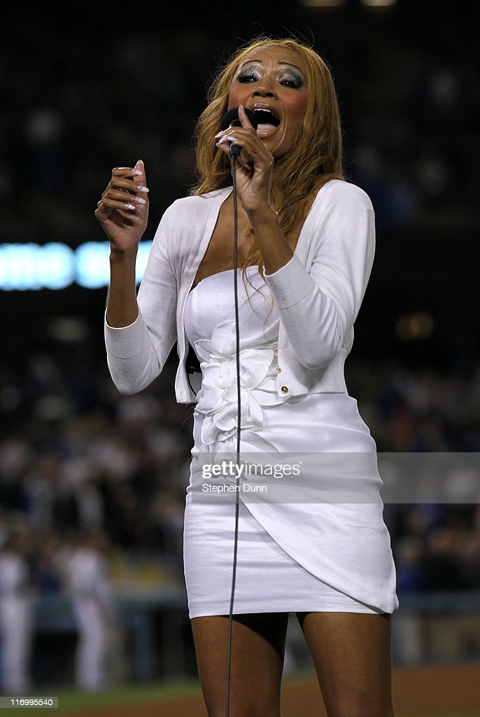Singer Ripley Fairchild performs 'God Bless America' during the seventh stretch in the game between the Houston Astros and the Los Angeles Dodgers on June 18, 2011 at Dodger Stadium in Los Angeles, California.
