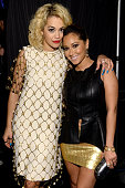 Singer Rita Ora and Adrienne Bailon attend the 4th Annual ELLE Women in Music Celebration at The Edison Ballroom on April 10 2013 in New York City