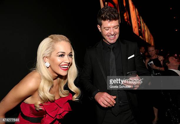 Singer rita Ora and Musician Robin Thicke attend amfAR's 22nd Cinema Against AIDS Gala Presented By Bold Films And Harry Winston at Hotel du...