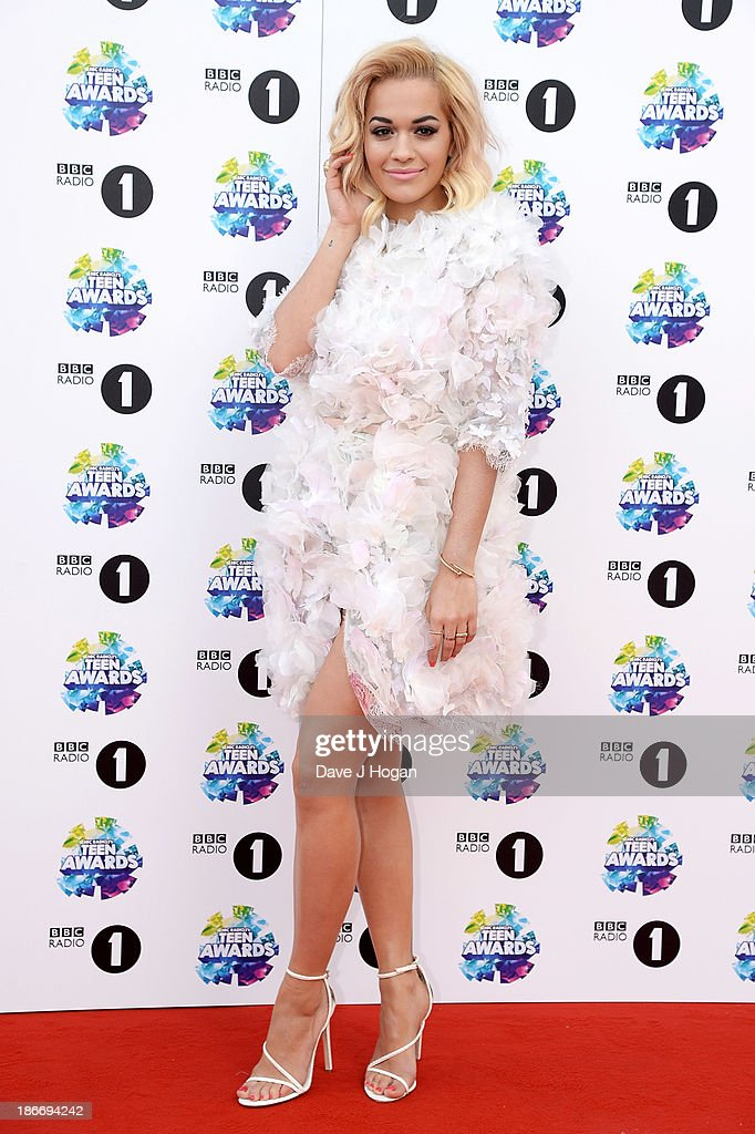 Singer <a gi-track='captionPersonalityLinkClicked' href=/galleries/search?phrase=Rita+Ora&family=editorial&specificpeople=5686485 ng-click='$event.stopPropagation()'>Rita Ora</a> attends the BBC Radio 1 Teen Awards at Wembley Arena on November 3, 2013 in London, England.