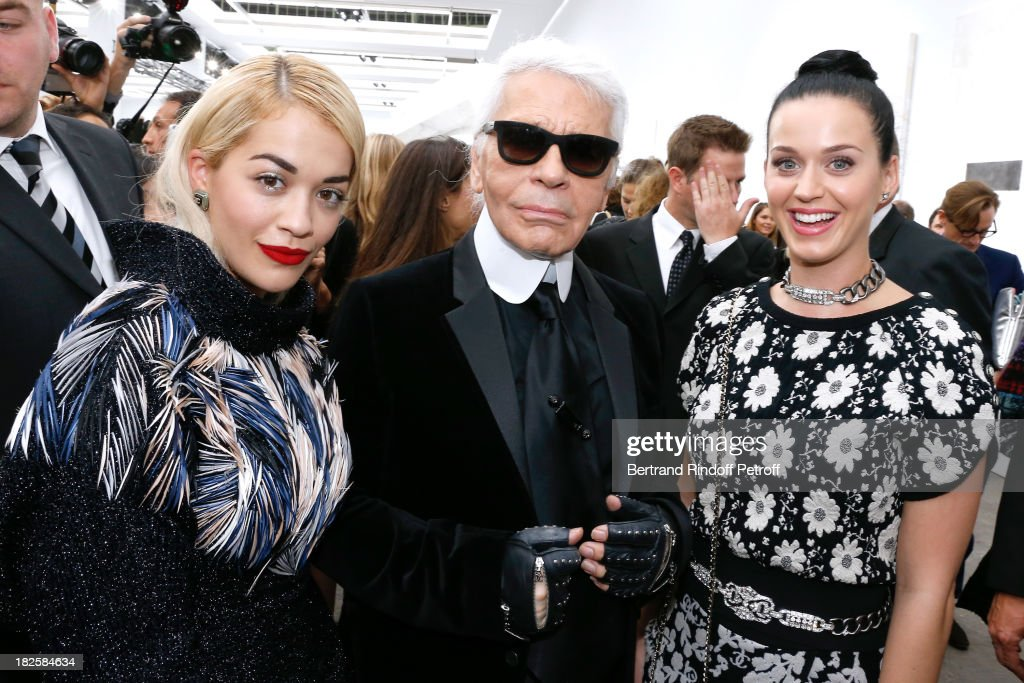 Singer <a gi-track='captionPersonalityLinkClicked' href=/galleries/search?phrase=Rita+Ora&family=editorial&specificpeople=5686485 ng-click='$event.stopPropagation()'>Rita Ora</a>, fashion designer Karl Lagerfeld and singer <a gi-track='captionPersonalityLinkClicked' href=/galleries/search?phrase=Katy+Perry&family=editorial&specificpeople=599558 ng-click='$event.stopPropagation()'>Katy Perry</a> after the Chanel show as part of the Paris Fashion Week Womenswear Spring/Summer 2014, held at Grand Palais on October 1, 2013 in Paris, France.