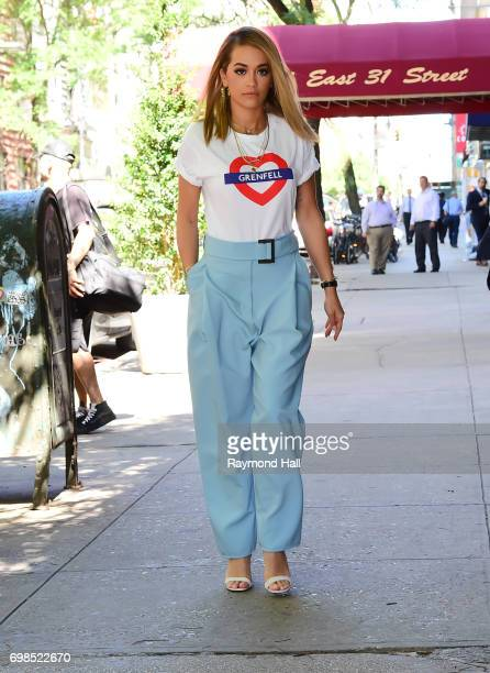 Singer Rita Ora is seen wearing a tshirt honouring the victims of the Grenfell tower block disaster while walking in Soho on June 20 2017 in New York...