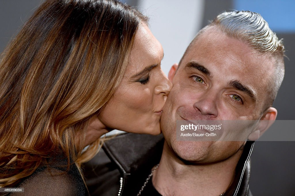 Singer Robbie Williams and wife Ayda Field arrive at the Tom Ford Autumn/Winter 2015 Womenswear Collection Presentation at Milk Studios on February...