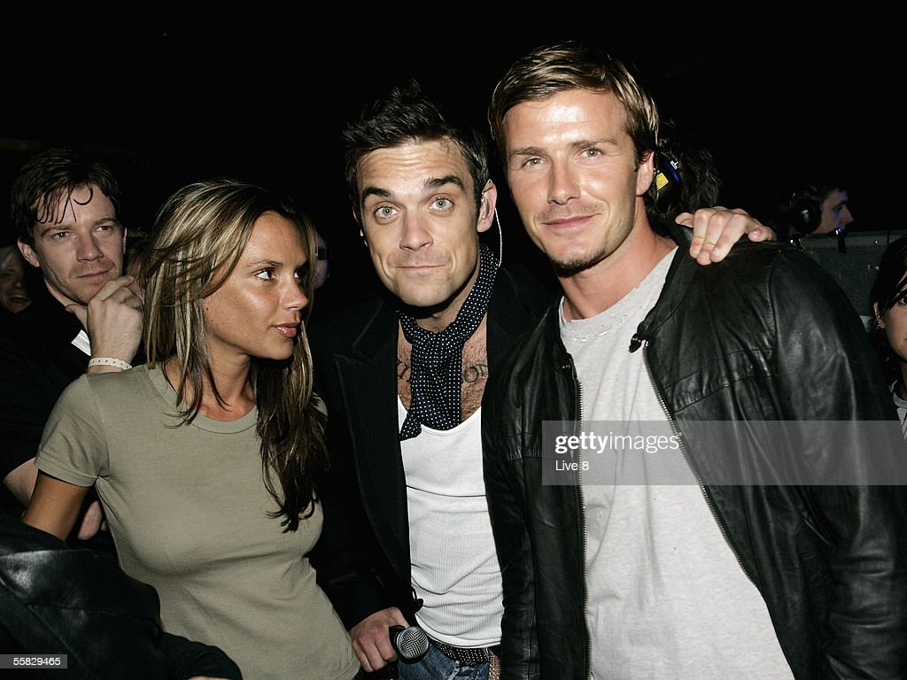 Singer Robbie Williams (C), captain of England football team <a gi-track='captionPersonalityLinkClicked' href=/galleries/search?phrase=David+Beckham&family=editorial&specificpeople=158480 ng-click='$event.stopPropagation()'>David Beckham</a> and his wife Victoria are seen in the wings of the stage at 'Live 8 London' in Hyde Park on July 2, 2005 in London, England. The free concert is one of ten simultaneous international gigs including Philadelphia, Berlin, Rome, Paris, Barrie, Tokyo, Cornwall, Moscow and Johannesburg. The concerts precede the G8 summit (July 6-8) to raise awareness for MAKEpovertyHISTORY.