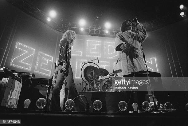 Singer Robert Plant and drummer John Bonham of British heavy rock group Led Zeppelin on stage at Earl's Court London May 1975 Behind Plant is bassist...