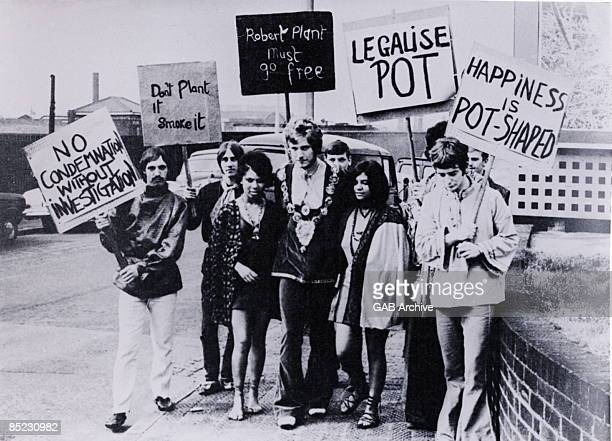 Singer Robert Plant later of Led Zeppelin and fellow Band Of Joy members John Elson Steve Taylor and Dave Evans pose with a group of drugs protesters...