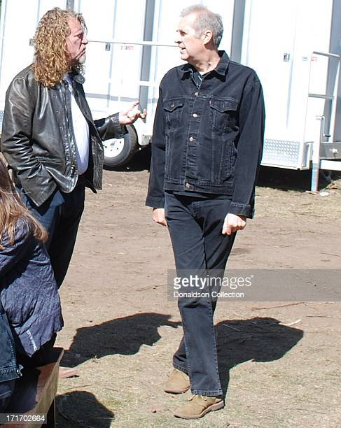 Singer Robert Plant talks with drummer Pete Thomas backstage at the Hardly Strictly Bluegrass Festival on October 4 2009 in San Francisco California