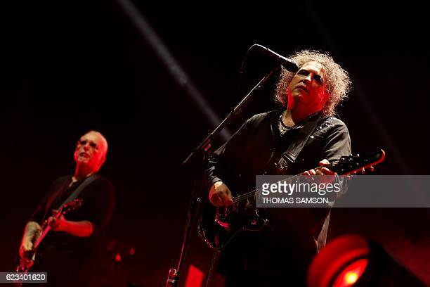 Singer Robert Smith and guitarist Reeves Gabrels of British rock band The Cure perform on stage during a concert at the Bercy Arena in Paris on...