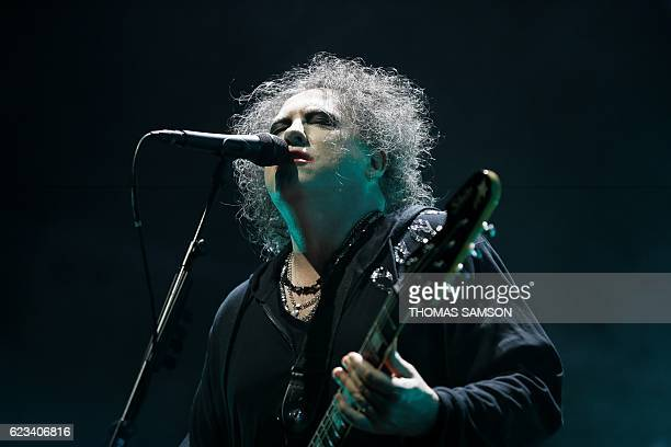 Singer Robert Smith of British rock band The Cure performs on stage during a concert at the Bercy Arena in Paris on November 15 2016 / AFP / Thomas...