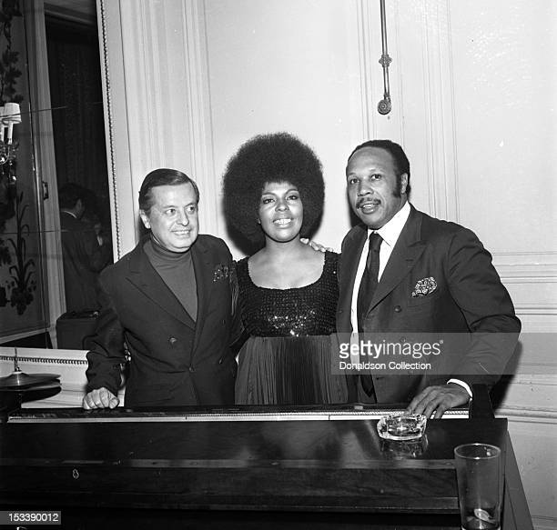 Singer Roberta Flack and record executive Nesuhi Ertegun pose for a photographer with other party guests at an Atlantic Records party in her honor at...