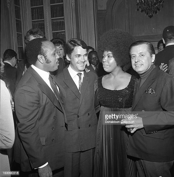 Singer Roberta Flack record executive Nesuhi Ertegun and party guests at an Atlantic Records party in her honor at the St Regis Hotel on November 17...