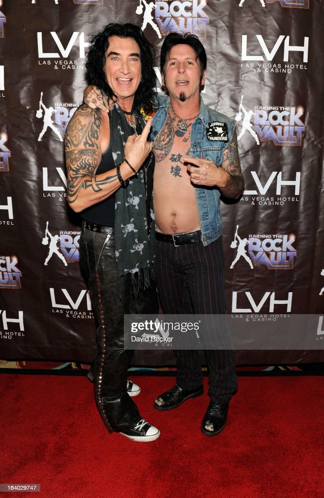 Singer Robin McAuley (L) and guitarist Tracii Guns arrive at the grand opening of 'Raiding the Rock Vault' at the Las Vegas Hotel & Casino on March 18, 2013 in Las Vegas, Nevada.