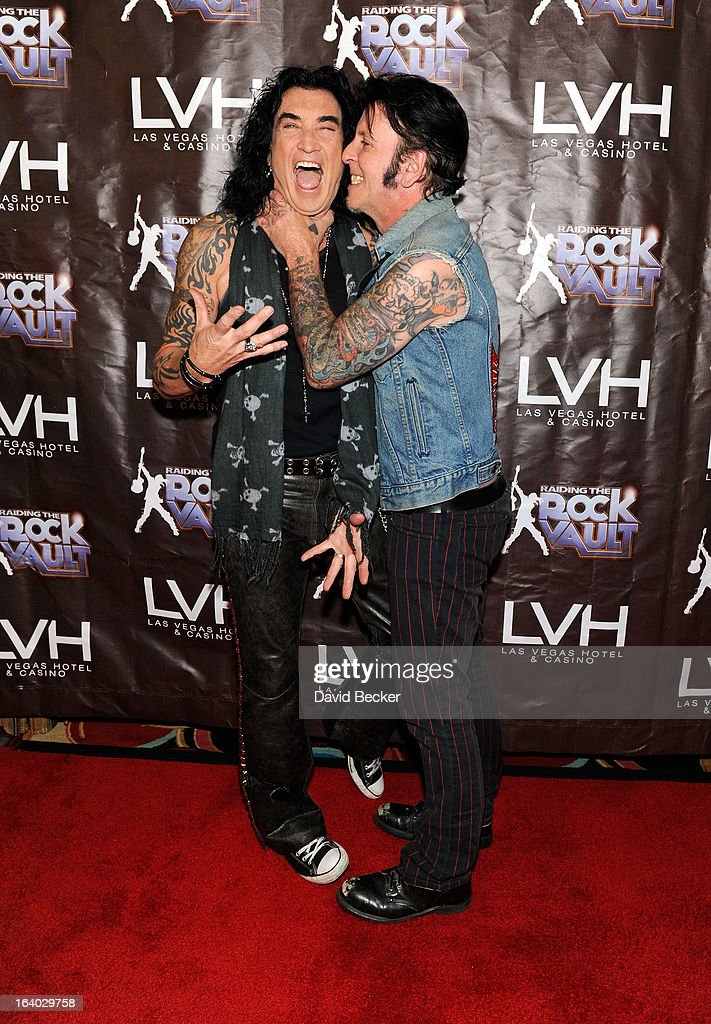 Singer Robin McAuley and guitarist Tracii Guns arrive at the grand opening of 'Raiding the Rock Vault' at the Las Vegas Hotel & Casino on March 18, 2013 in Las Vegas, Nevada.